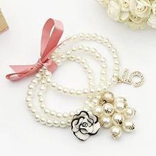 Chanel / Chanel tela rosa de flores de diamantes arco brazalete de perlas de resina L0835