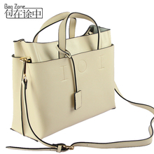 The new 2014 han edition IOI star magazine with cowhide leather female BaoChao one shoulder aslant female bag mail