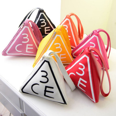 The unique design of three-dimensional triangular fashion candy color PU phone bag purse cosmetic bag small bag PU